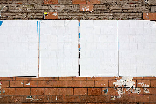 four real blank billboards on a dilapidated wall - poster stock pictures, royalty-free photos & images
