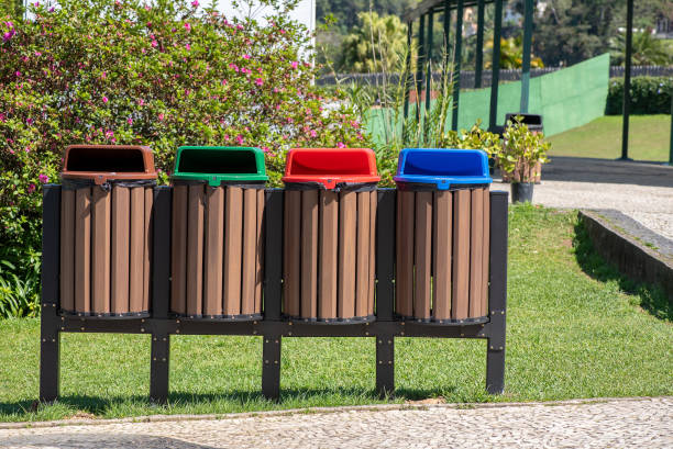 Four recycling bins in the park stock photo