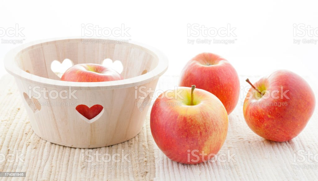 Four Red Kiku Apples and Basket with Hearts royalty-free stock photo