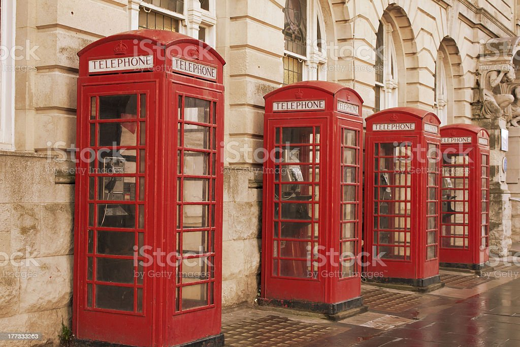 Four red phone boxes royalty-free stock photo