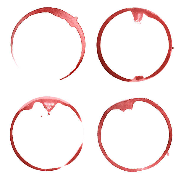 Four red wine stains caused by the bottoms of wine glasses stock photo