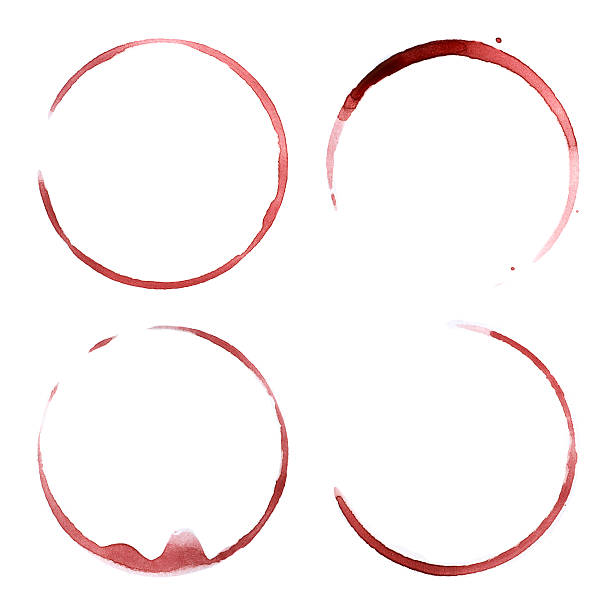 Four red wine stains stock photo