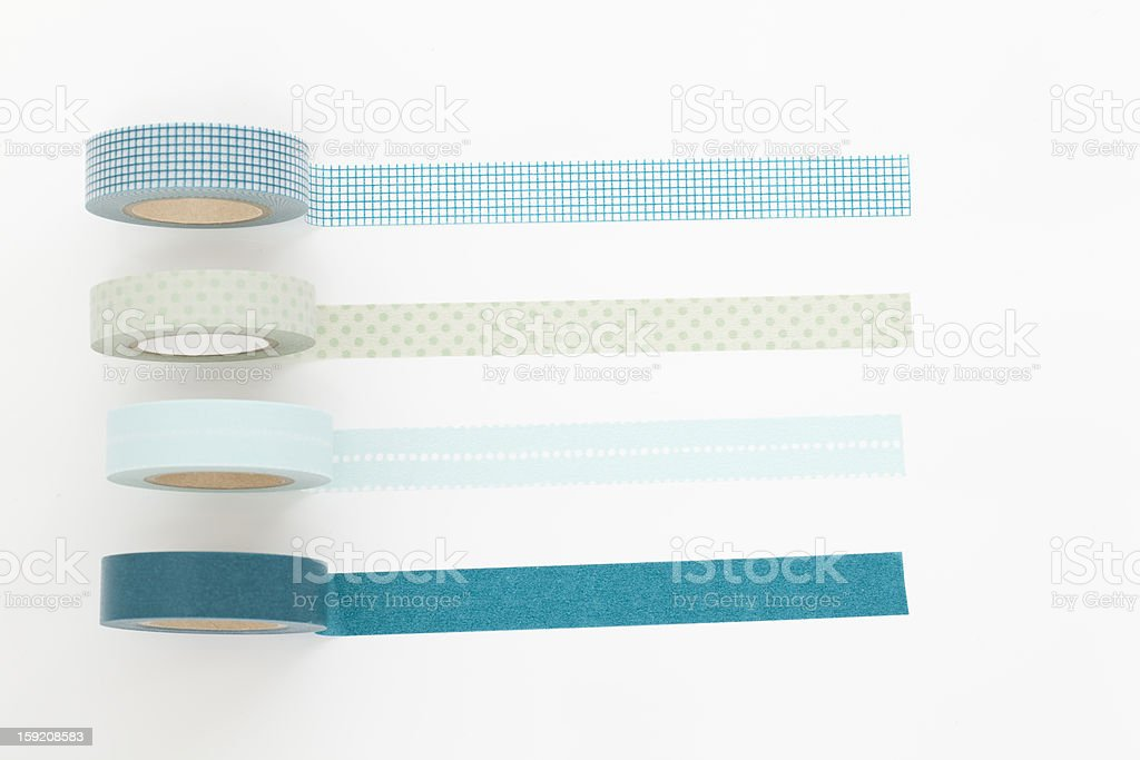 Four rolls of different colored tape stock photo