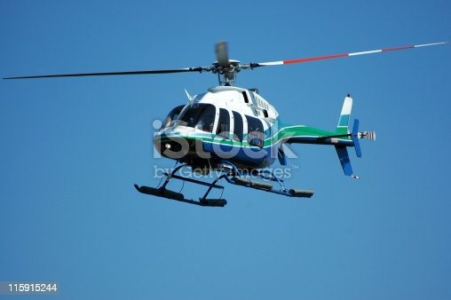 Four rotor, seven passenger helicopter. This helicopter model is also used as an air ambulance. Bell 407.
