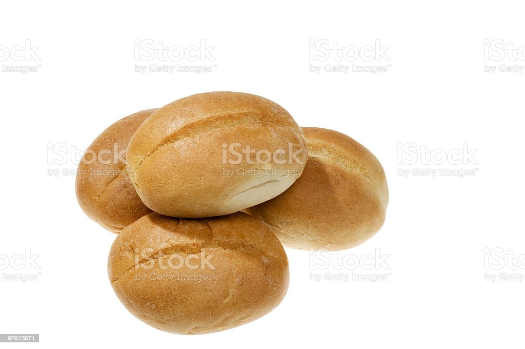 Four round rolls of bread on white background stock photo