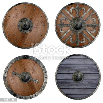 istock Four round wooden shields with assorted metal decorations 178874361