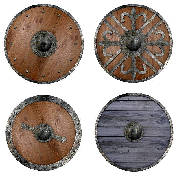 Four round wooden shields with assorted metal decorations collection of 3d renders - shields shielding stock pictures, royalty-free photos & images