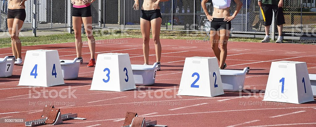 Four runners at the starting line royalty-free stock photo