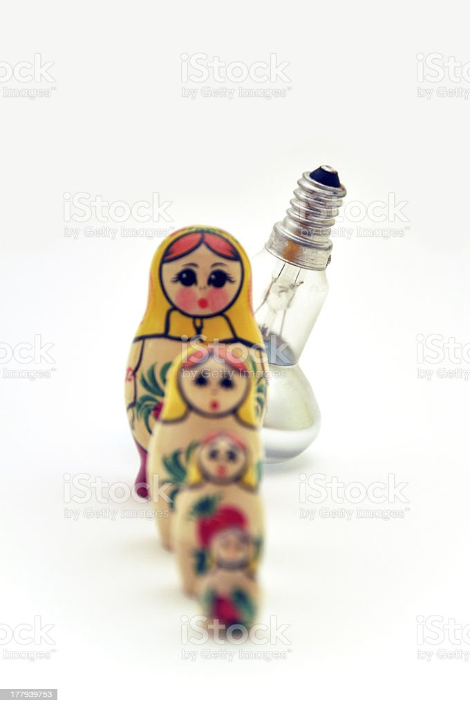 Four Russian dolls and Bulb in a line royalty-free stock photo