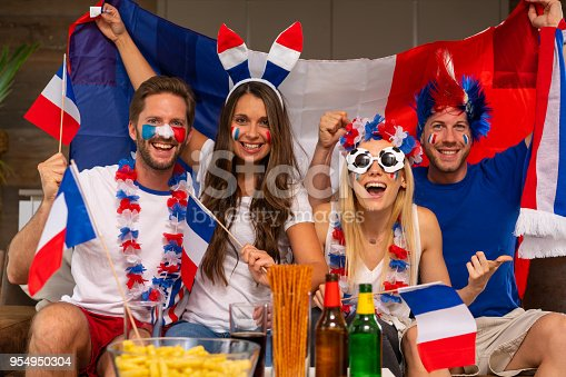 sports fans from russia or france cheering for their team competing at the soccer world cup