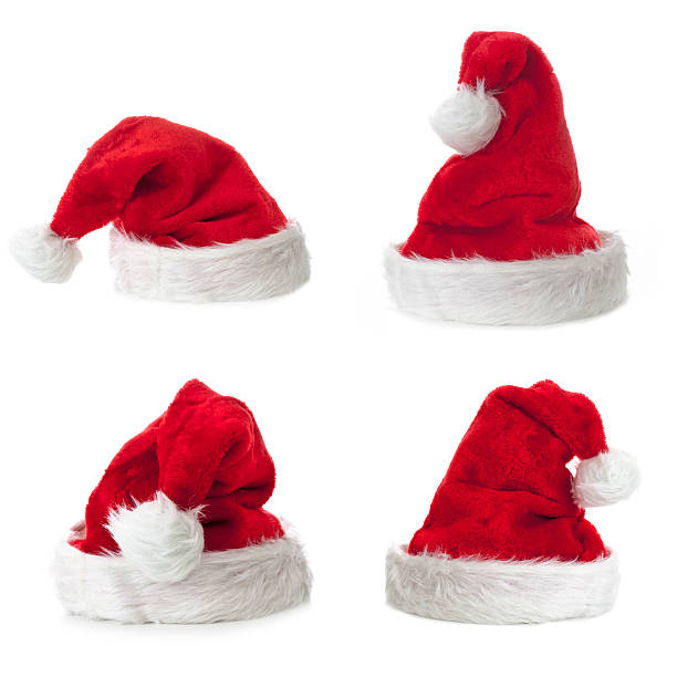 Four Santa Claus hat on white background Four Santa Claus hat on white background. knit hat stock pictures, royalty-free photos & images