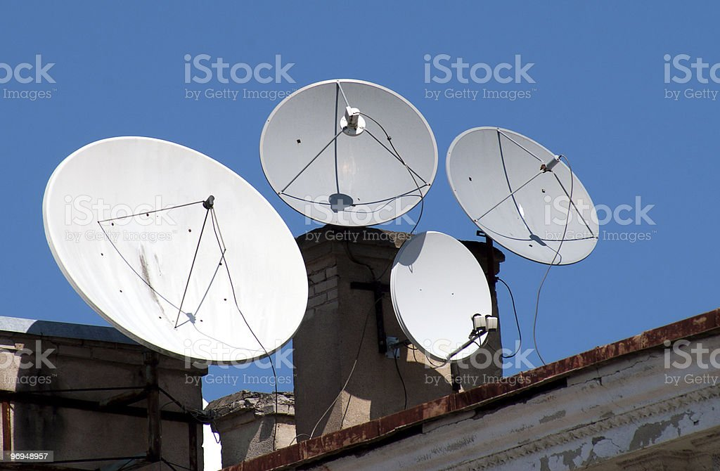 Four satellite dish antennas royalty-free stock photo