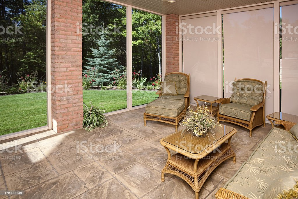 Four Seasons Sun Room With Wicker Furniture and Outdoor View royalty-free stock photo