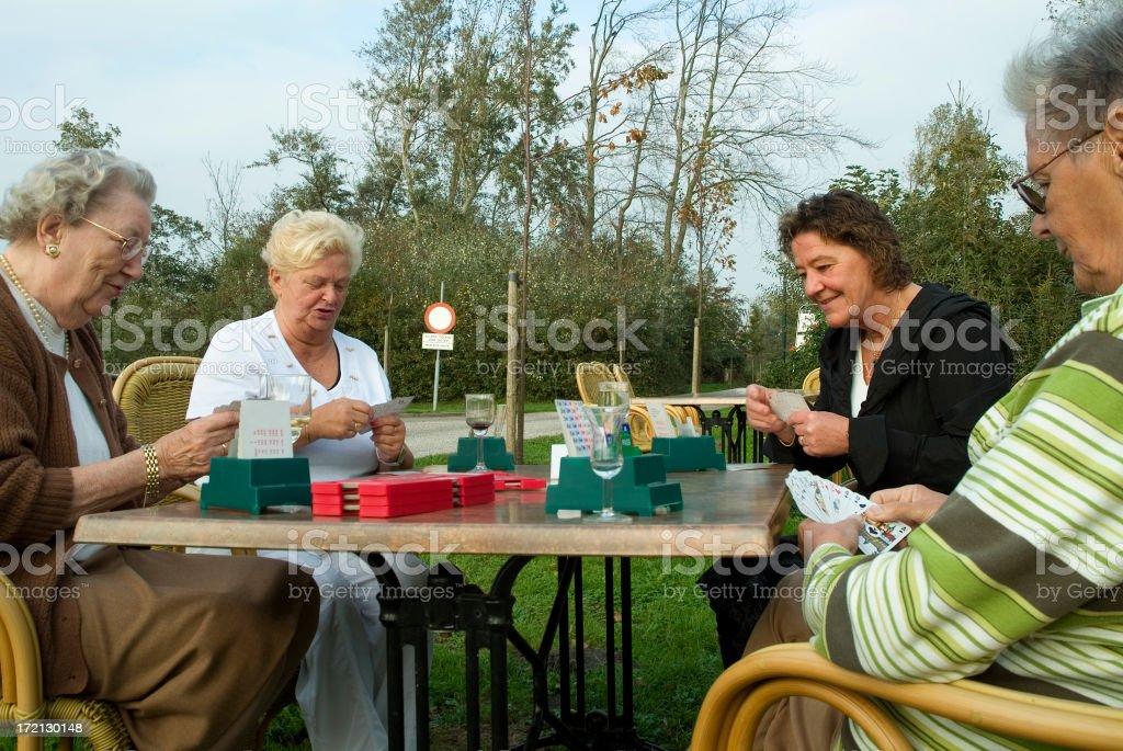 Four senior bridge players in the garden royalty-free stock photo