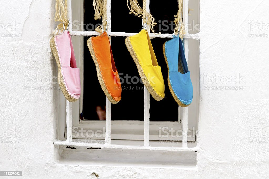 Four shoes hanging stock photo