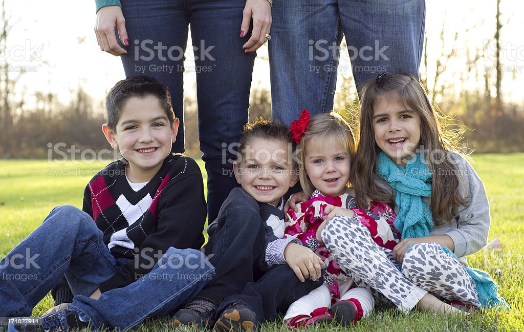 four siblings smile together royalty-free stock photo
