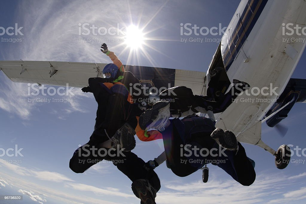 Four Skydivers Exiting an Airplane royalty-free stock photo