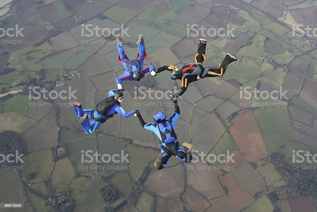 Four Skydivers in a star formation stock photo