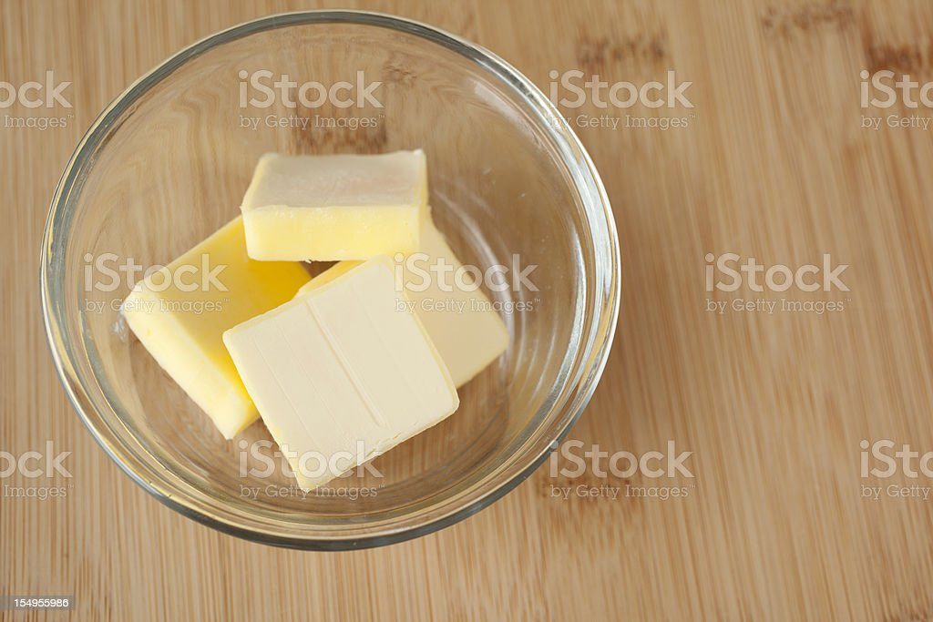 Four Slices of Butter in a Bowl royalty-free stock photo