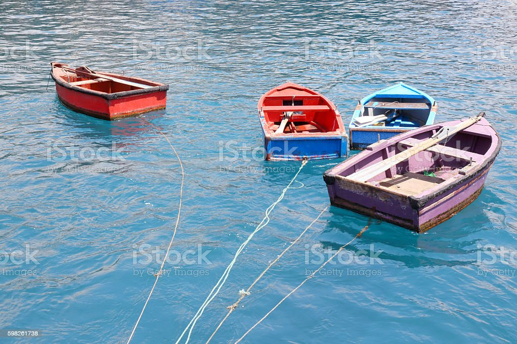 Four small boats stock photo