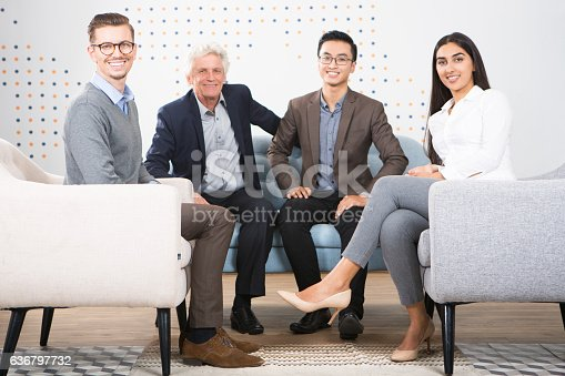istock Four Smiling Diverse Business Partners in Lounge 636797732