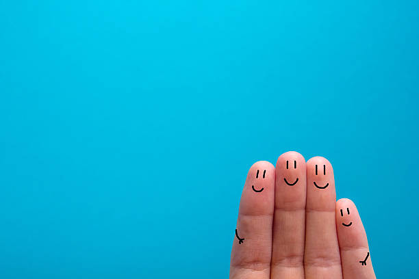 four smiling fingers that are very happy to be friends - finger stock photos and pictures