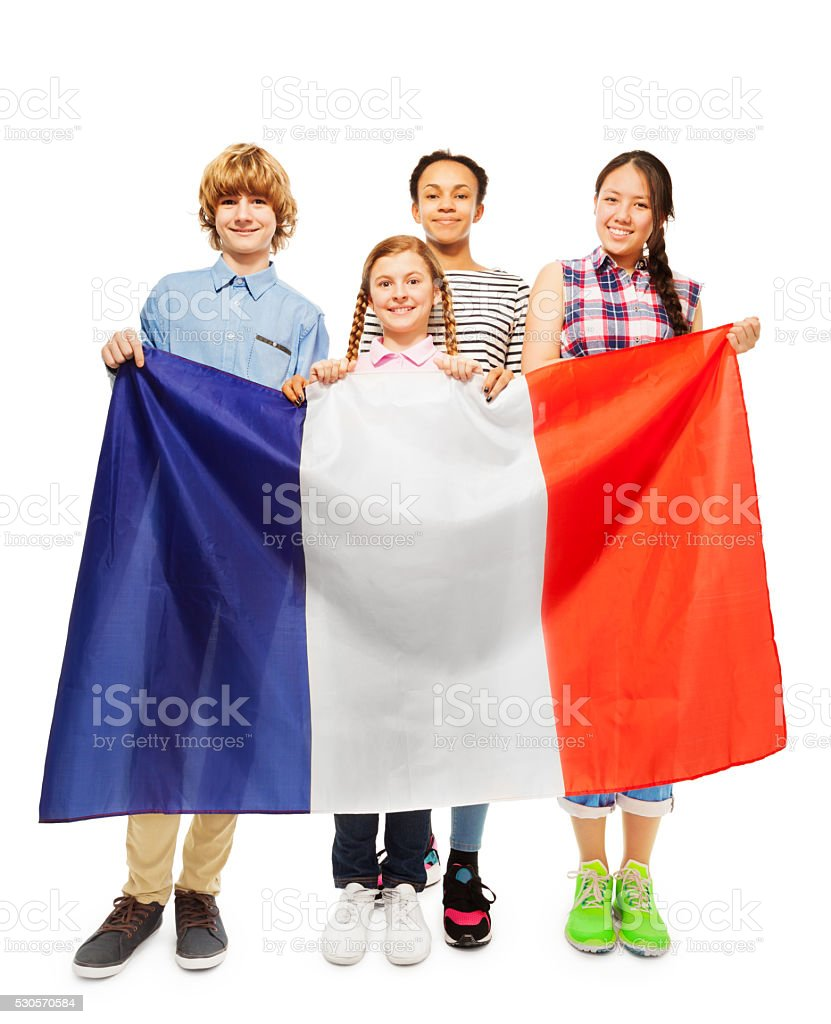 Four smiling multiethnic students from France stock photo