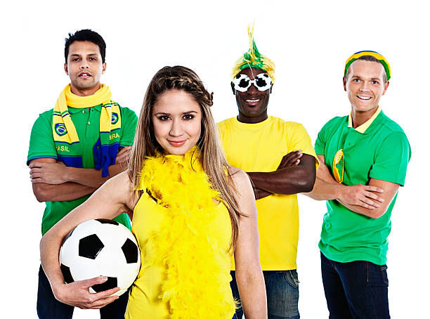 Four smiling soccer fans in Brazilian team colors Four smiling soccer fans in Brazilian colors get together to support their team. fan club stock pictures, royalty-free photos & images