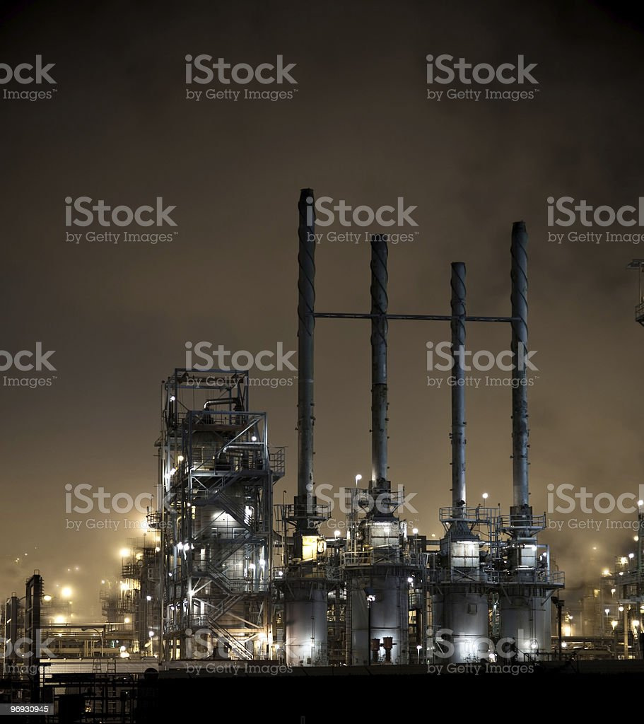 Four Smokestacks at Night royalty-free stock photo