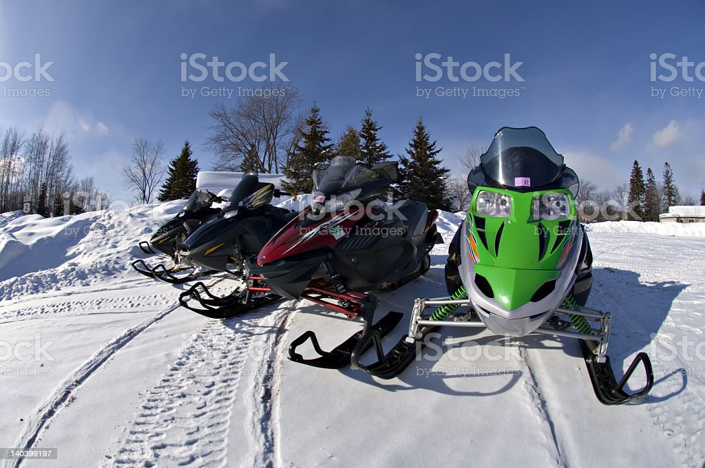 Four snow moblies in Upper Michigan stock photo