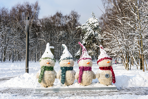 Four snowmen in the park Kuzminki in Moscow. Russia.