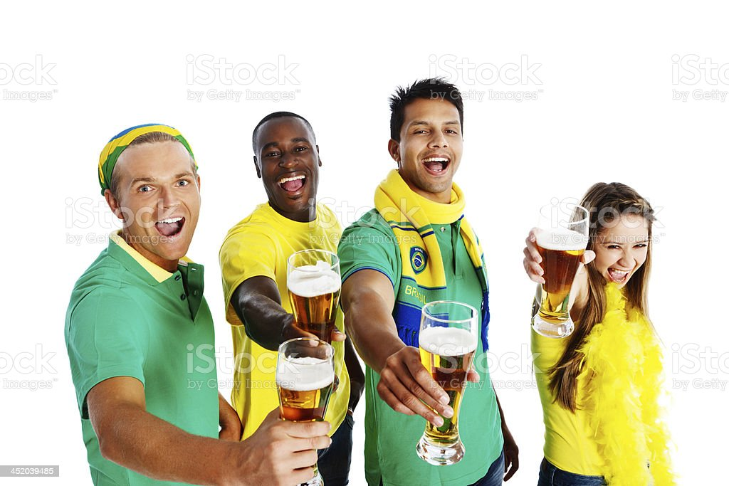 Four soccer fans in team colors toast their side royalty-free stock photo