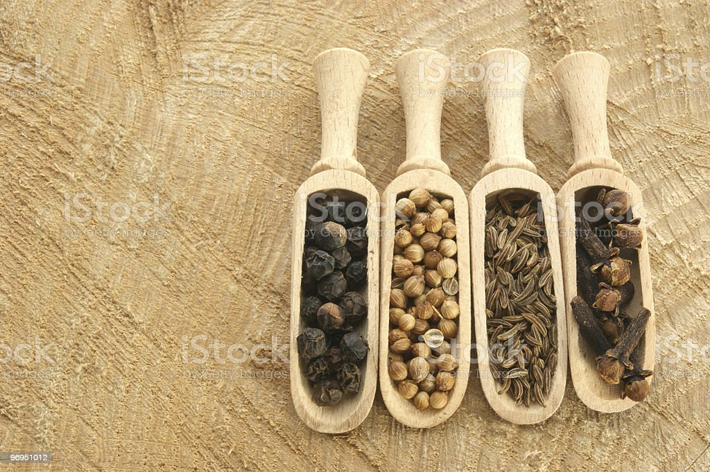 four spices, pepper, coriander, cloves and caraway seed royalty-free stock photo