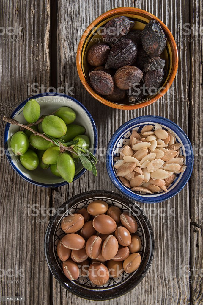 Four stages of Argan fruits stock photo