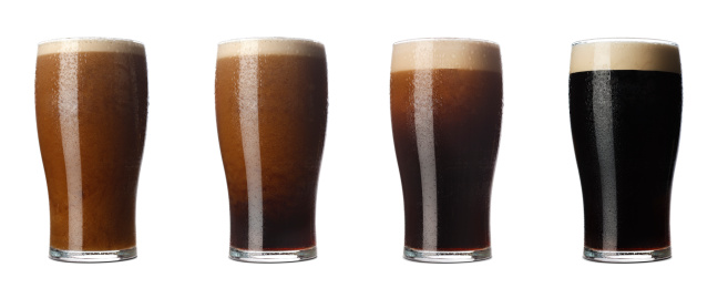 Four stages of a pint of stout from the moment it is poured till it is ready to drink.