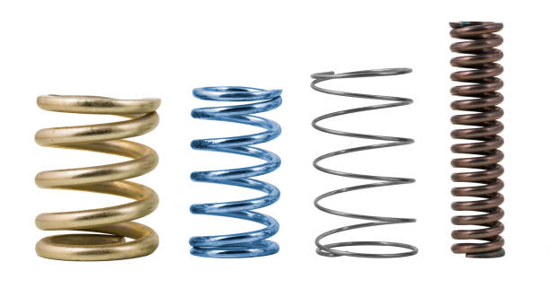 Four steel helical compression coil springs with varied surface finish isolated on a white background stock photo