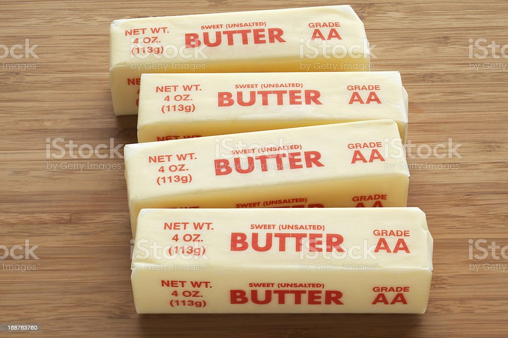 Four sticks of sweet unsalted butter in wrappers  stock photo