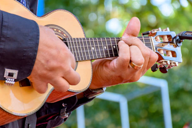 Four strings acoustic guitar player stock photo