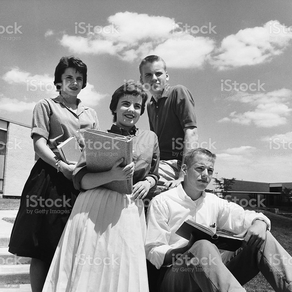 Four students on steps, posing royalty-free stock photo