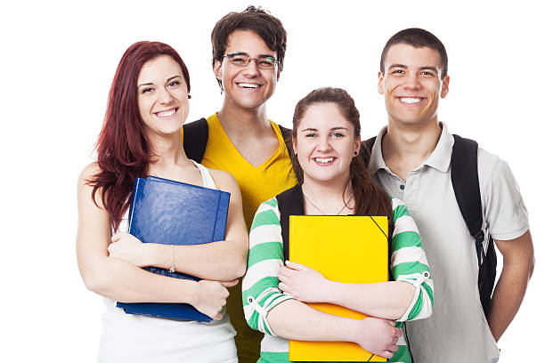 vier studenten lächelnd auf weiß - marko skrbic stock-fotos und bilder