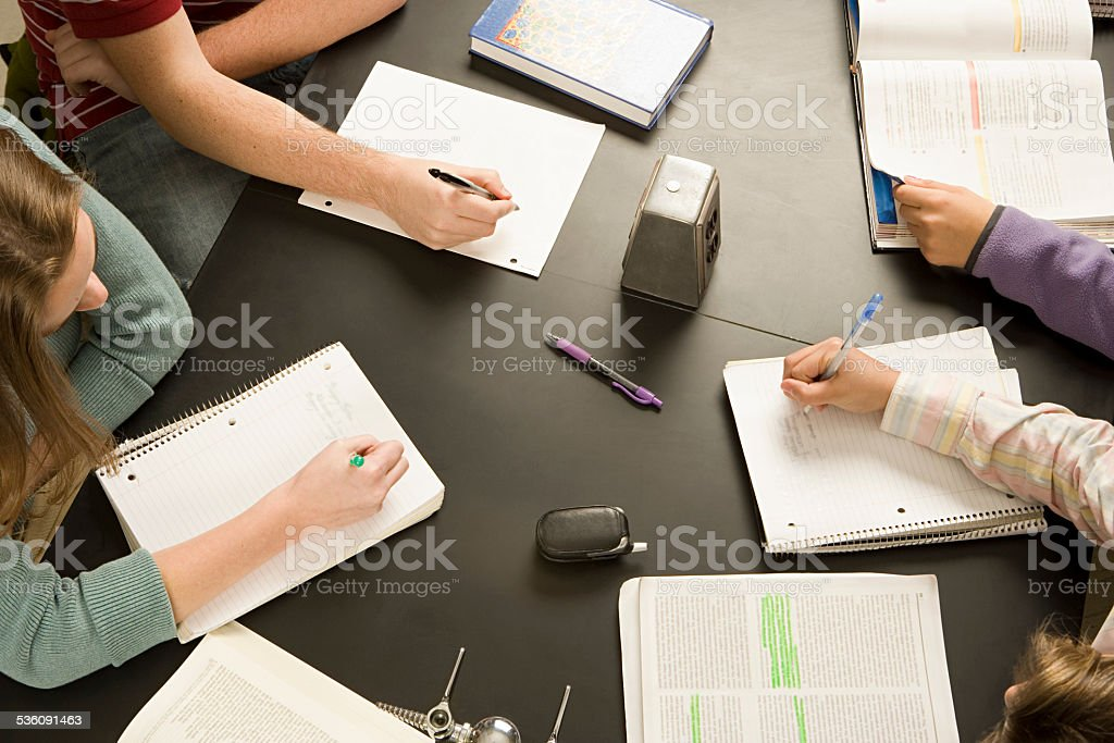 Four students working in a classroom stock photo