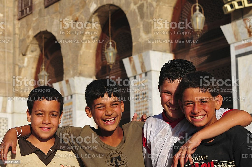 Syrian boys in the Umayyad Mosque at Damascus royalty-free stock photo