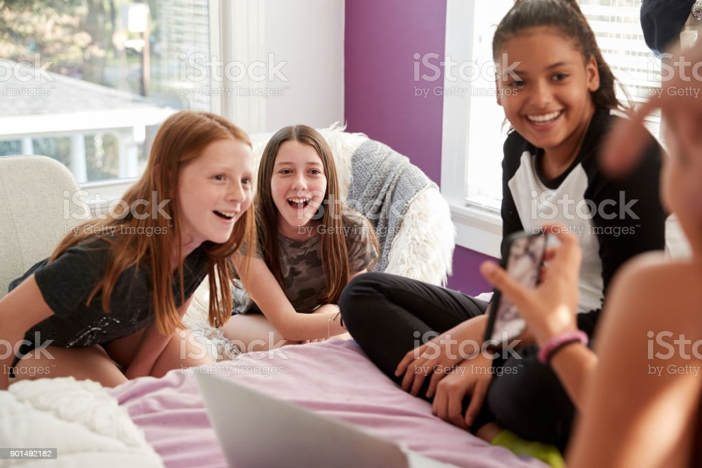 Four Teen Girls In Bedroom Looking At Smartphone Close Up Stock Photo Download Image Now Istock