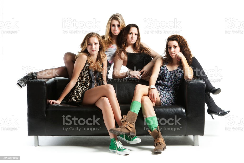 Four Teen Models with Black Sofa on White Background Hz stock photo
