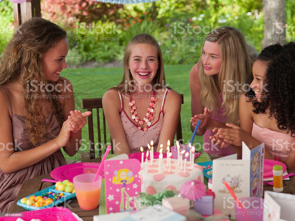 Four teenage girls at birthday party smiling outdoors royalty-free stock photo