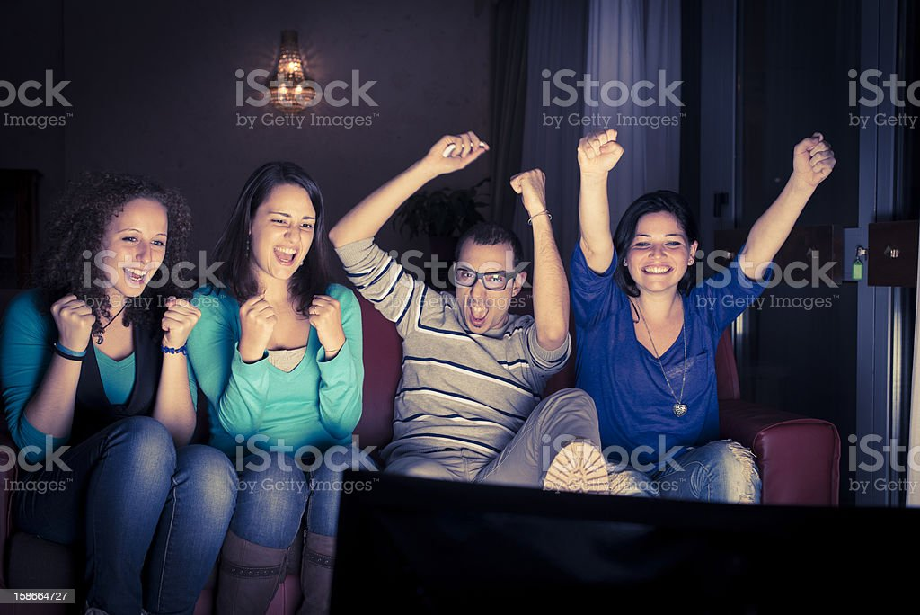 Four teenager watching tv stock photo