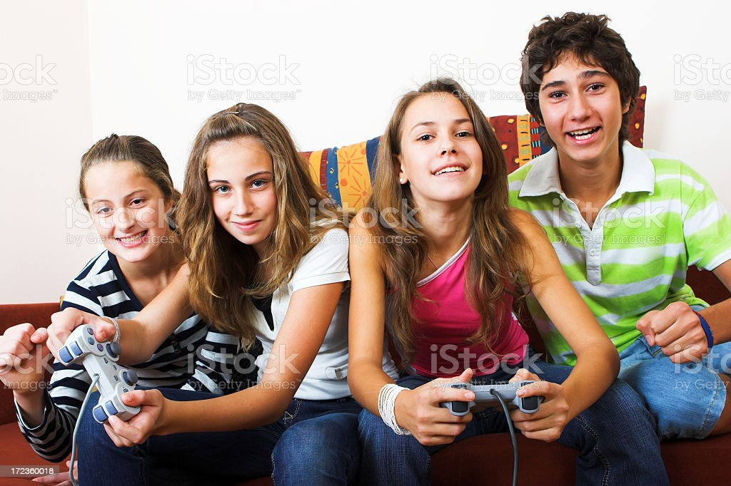 Four teenagers playing video games together royalty-free stock photo