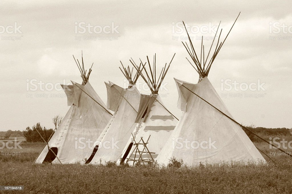 Four teepees stock photo
