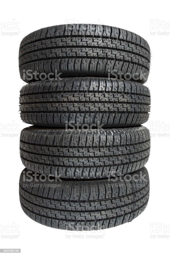Four tires piled up stock photo