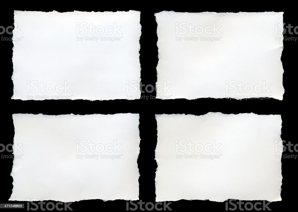 Four torn pieces of paper on a black background stock photo